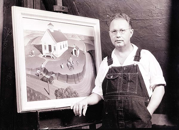 Grant Wood next to his painting Midnight Ride